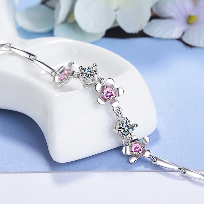 Sukkhi Ritzy Adjustable Pink Crystal Rhodium Plated Bracelet for Women