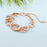 Sukkhi Exotic Twisted Round Pink Crystal Gold Plated Bracelet for Women