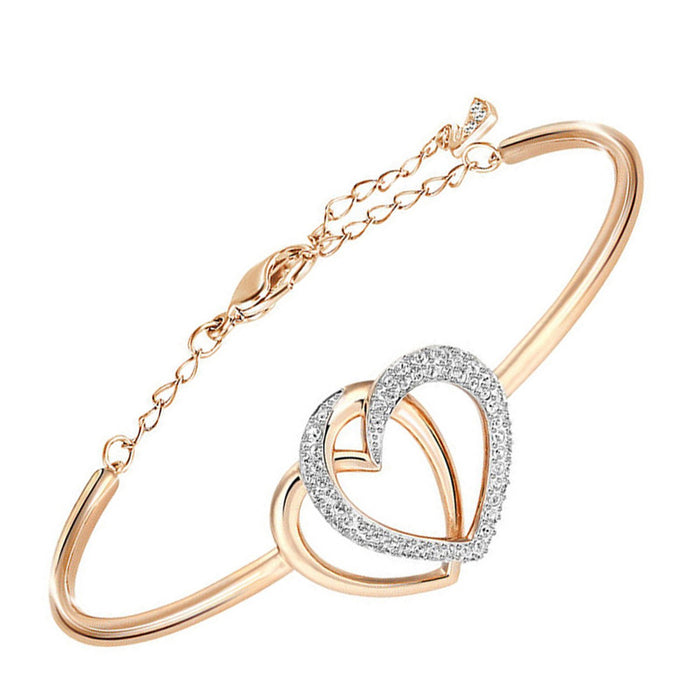 Sukkhi Shimmering Alloy Crystal Pink Gold-plated Bracelet for Women