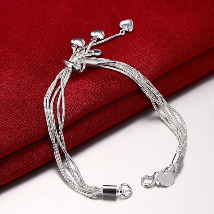 Sukkhi Exclusive  Valentine Heart Rhodium Plated Metal Bracelet for Women