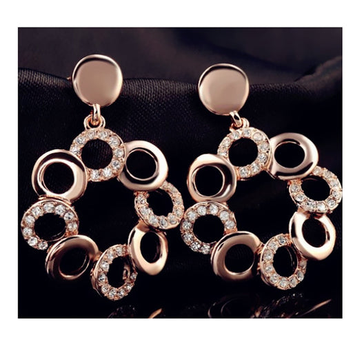 Sukkhi Cluster Twisted Round Pink Cubic Zirconia Gold Plated Earring for Women