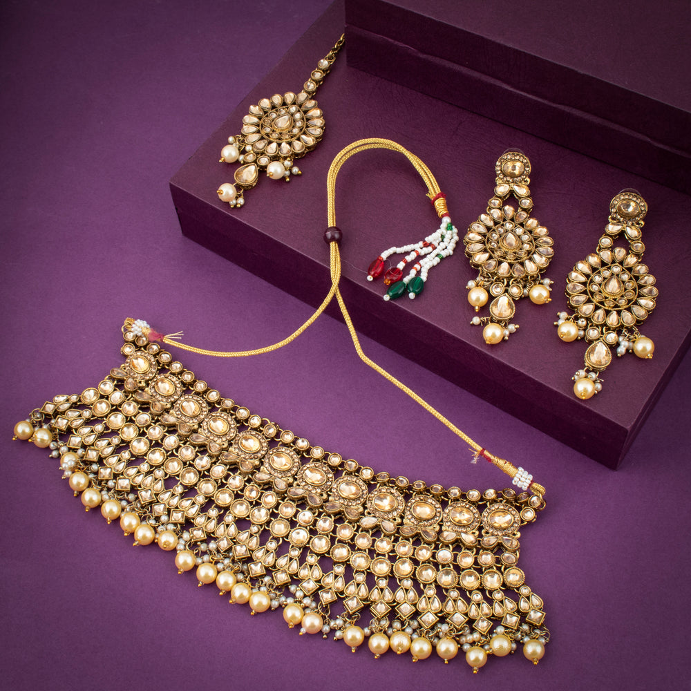 Sukkhi Exotic Gold Plated Choker Necklace Set with Maangtikka for Women