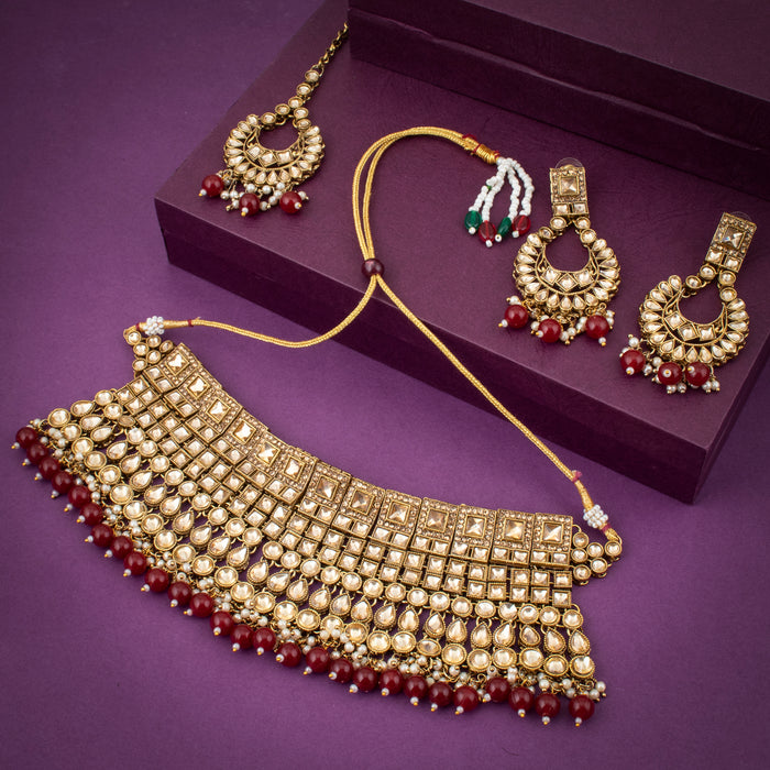 Sukkhi Gleaming Gold Plated Choker Necklace Set with Maangtikka for Women