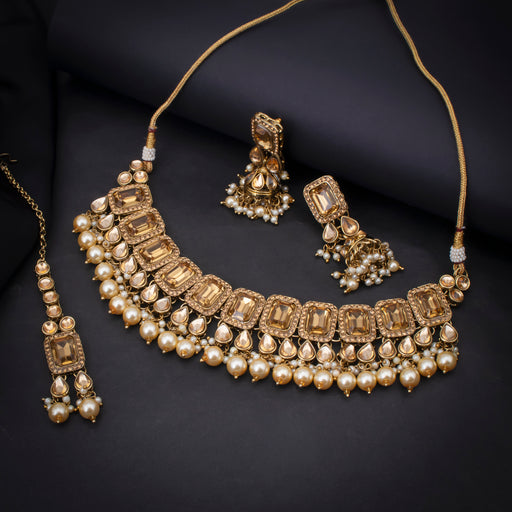 Sukkhi Ravishing Gold Plated Choker Kundan Pearl Necklace Set with Maangtikka for Women