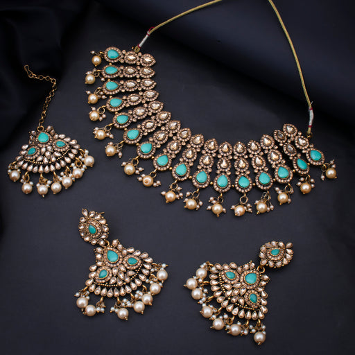 Sukkhi Intricately Gold Plated Choker Kundan Pearl Necklace Set with Maangtikka for Women