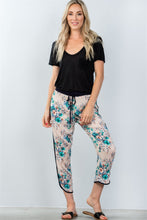 Ladies fashion drawstring blush floral printed contrast trim casual pants - Creole Couture Boutique