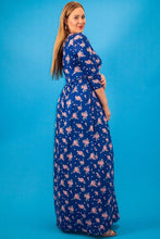 Striped Floral Print Maxi Dress In A Relaxed Fit And Flare Style With A Wrapped V-neck, Short Sleeves, Side Pockets And Waist Tie Belt - Creole Couture Boutique