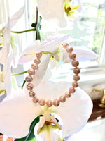 Light Pink Knotted Pearl Bracelet