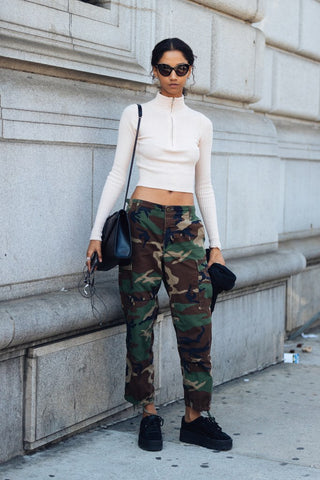 Flattering camo look for women with fitted crop top and classic camo pants
