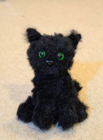 Black fluffy Persian Cat plush. Handmade crochet stuffed cuddly toy.