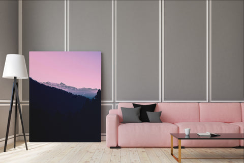 Pink and black mountain landscape canvas print, standing on the floor in living room