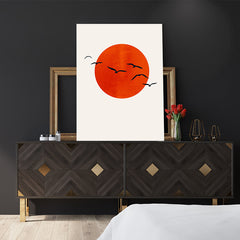 Poster print by Kubistika with intense orange sun and black birds, on beige background, bedroom view