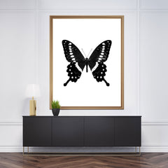 Gorgeous poster print with a black and white butterfly on white background - frame view