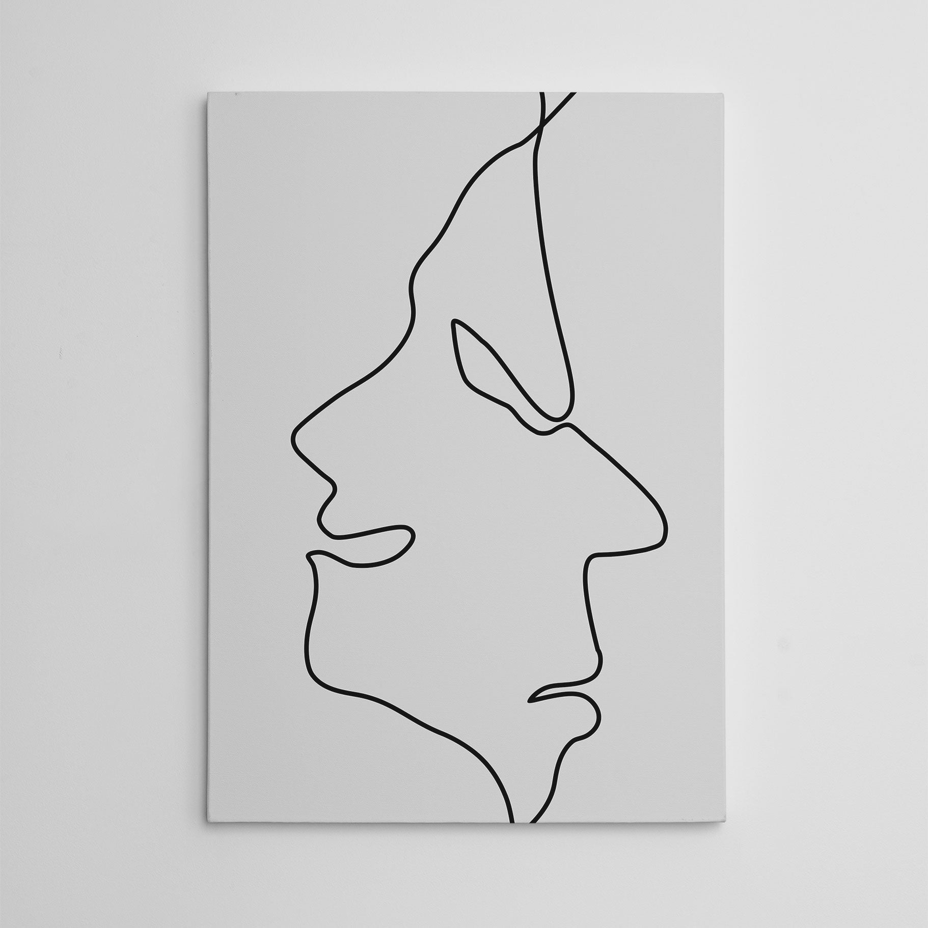 Line art canvas print with abstract happy and sad faces drawing.