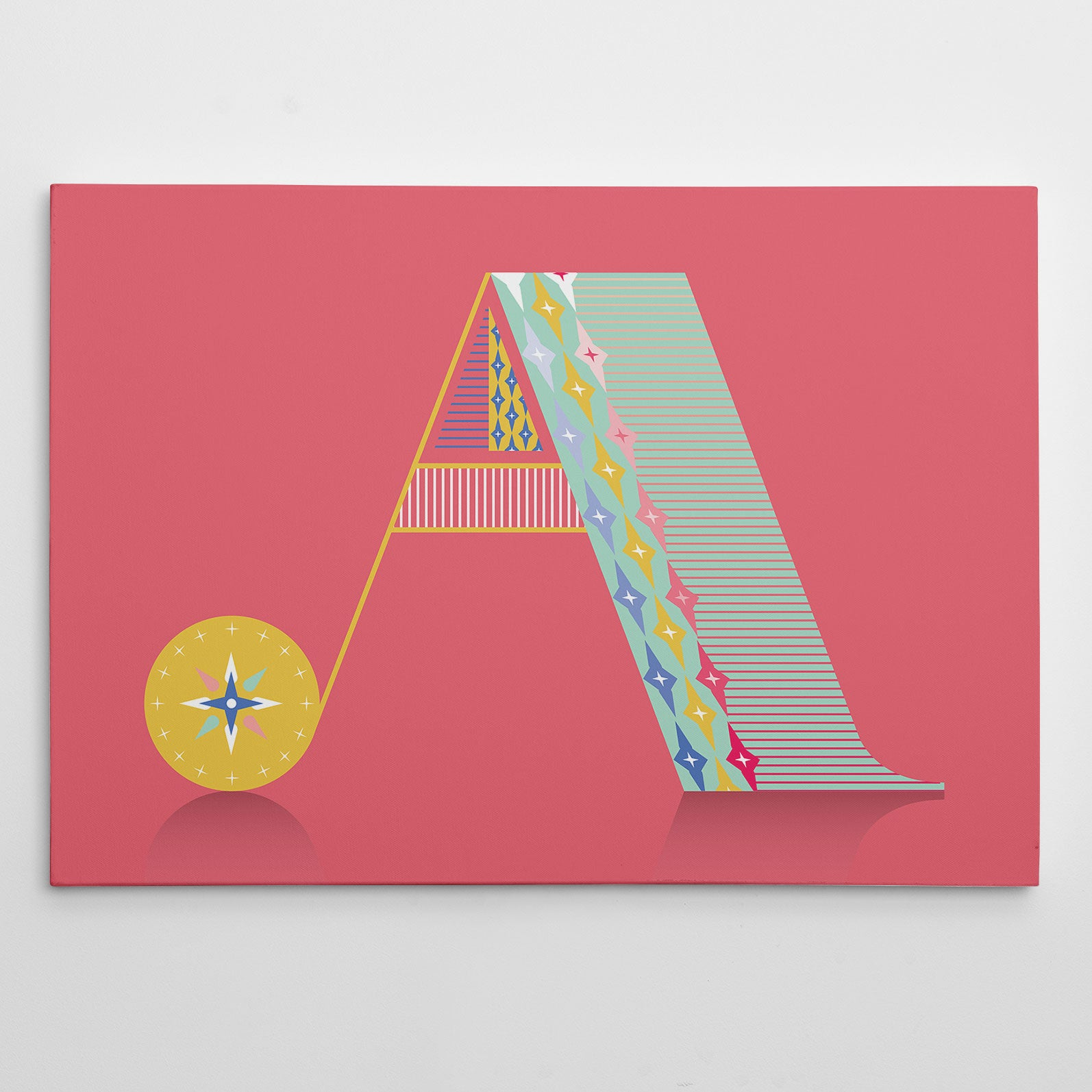 Canvas print with patterned letter A, on pink background.