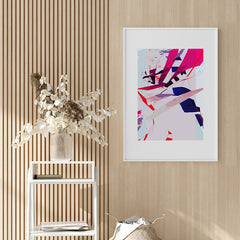 Abstract poster print with pink, purple and blue shapes, in hallway