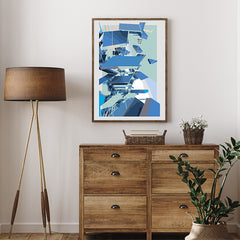 Digital geometric art print by Henry Hu with grey, mint and blue shapes, on hallway