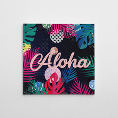 "Illustration canvas print with colourful leaves and pink word ""Aloha""."