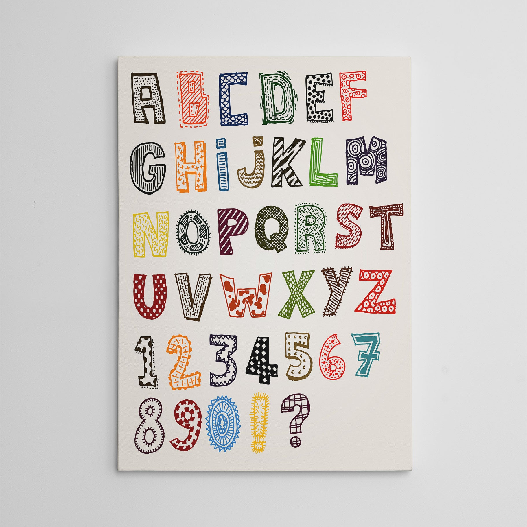 Educational canvas print with patterned letters and numbers.