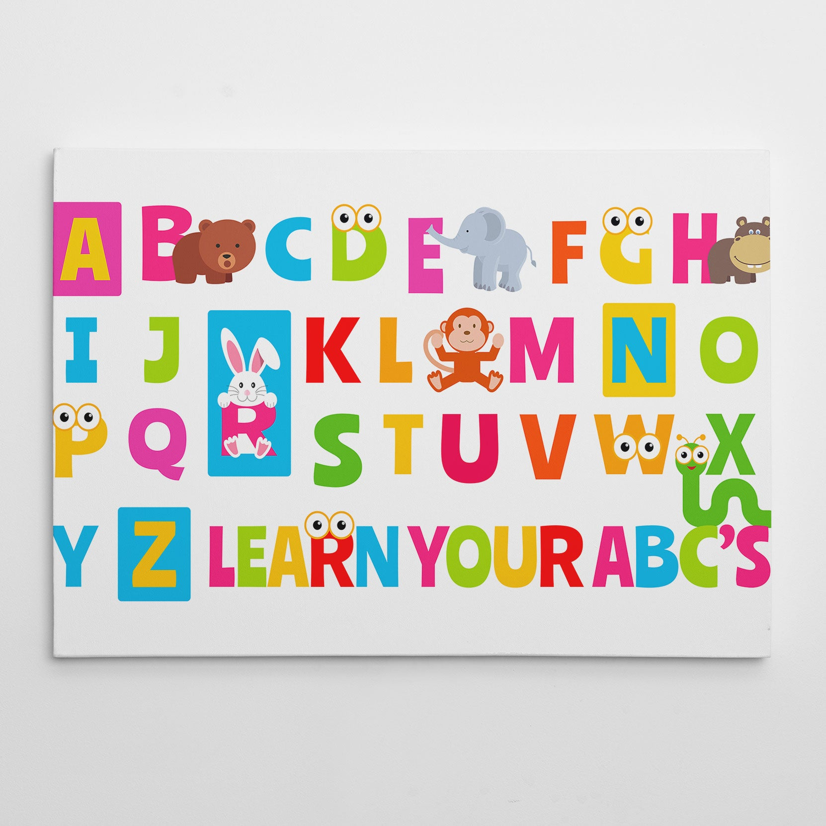Canvas print with colourful alphabet letters and animals, on white background.