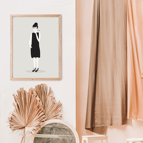 Celebrity illustration print with Audrey Hepburn stylishly drawn by Judy Kaufmann to bring out the essence of her style and character, in hallway