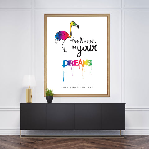 Poster print with a rainbow flamingo and the quote 'believe in your dreams, they know the way', on white background, framed