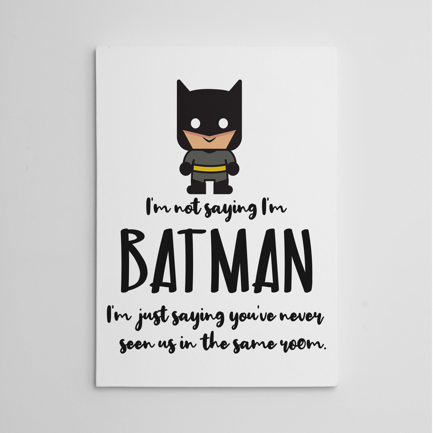 "White canvas print with the black text ""I'm not saying I'm Batman, I'm just saying you've never seen us in the say room"" and Batman's cartoon figure."