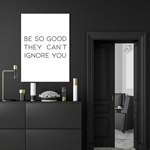 "Typography inspired canvas print, with black text ""Be so good they can't ignore you"" - room view"