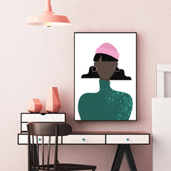 Fashion poster print by Linda Gobeta, with an abstract woman in green, wearing a pink beanie hat, wall view