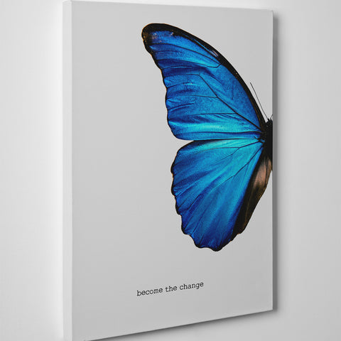 "Gorgeous canvas print with a blue butterfly and the inspirational quote ""Become the change"", on grey background - side view"