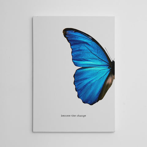 "Gorgeous canvas print with a blue butterfly and the inspirational quote ""Become the change"", on grey background"