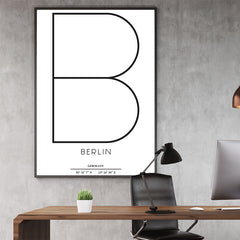 Typography poster print by Kubistika, with ''B'' for Berlin, Germany and latitude & longitude coordinates, on white background, office view