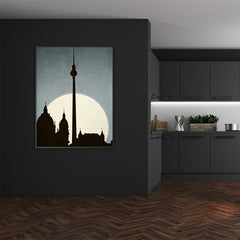 Textured illustration print by Kubistika, with a sunrise behind iconic landmarks in Berlin, on dusty blue background, dining room view