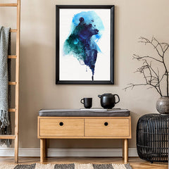 Watercolour poster print with a blue bear and forest, on crinkled light grey background, in hallway