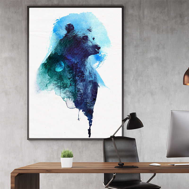 Watercolour poster print with a blue bear and forest, on crinkled light grey background, in office