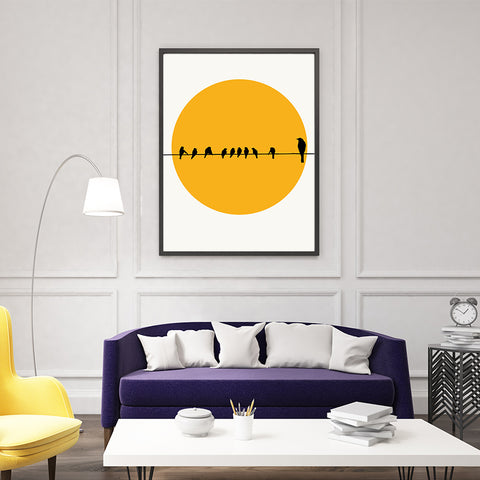 Poster print by Kubistika, with yellow sun and black birds on a rope, on light grey background, living room view.