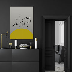 Canvas print with yellow sun and black birds, on grey textured paper effect background - room view