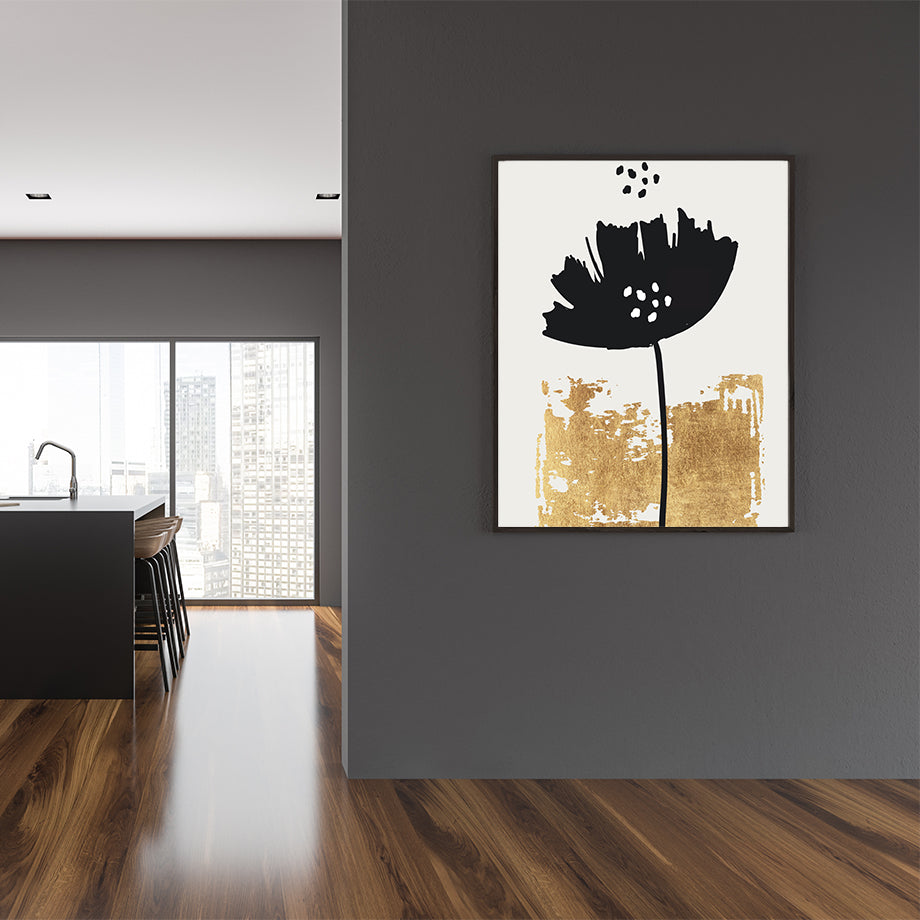 Illustration poster print by Kubistiksa, with black poppy and gold motif, on light grey background, framed in dining room