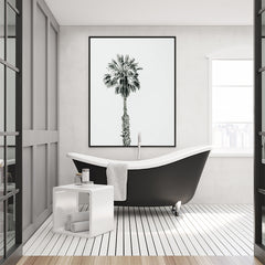Photography poster print with a black and white palm tree, in bathroom