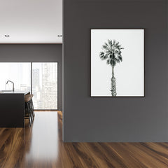 Photography poster print with a black and white palm tree, in dining room