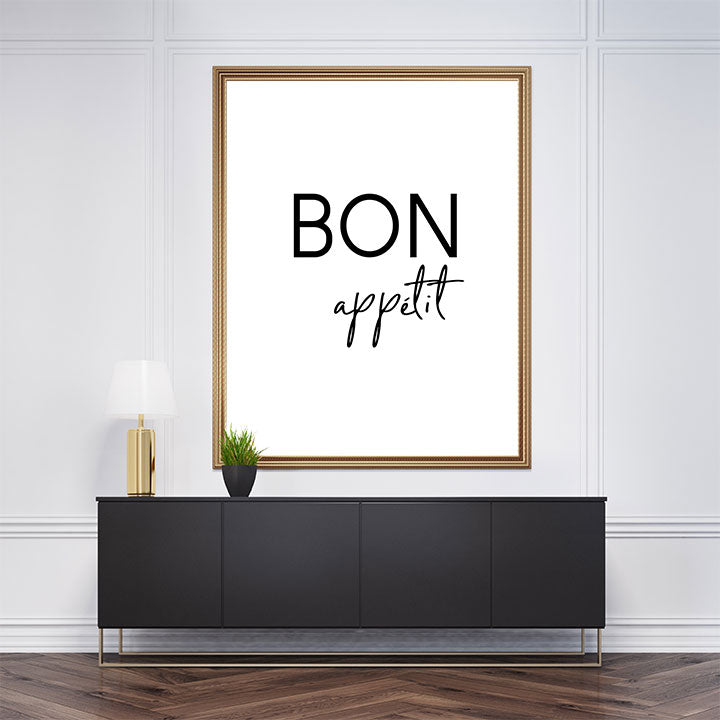 "Black and white typography poster print with the quote ""Bon apetit"", framed"
