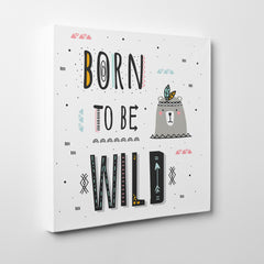 "Kids square canvas print with black text ""Born to be wild"", on a white background - side view"