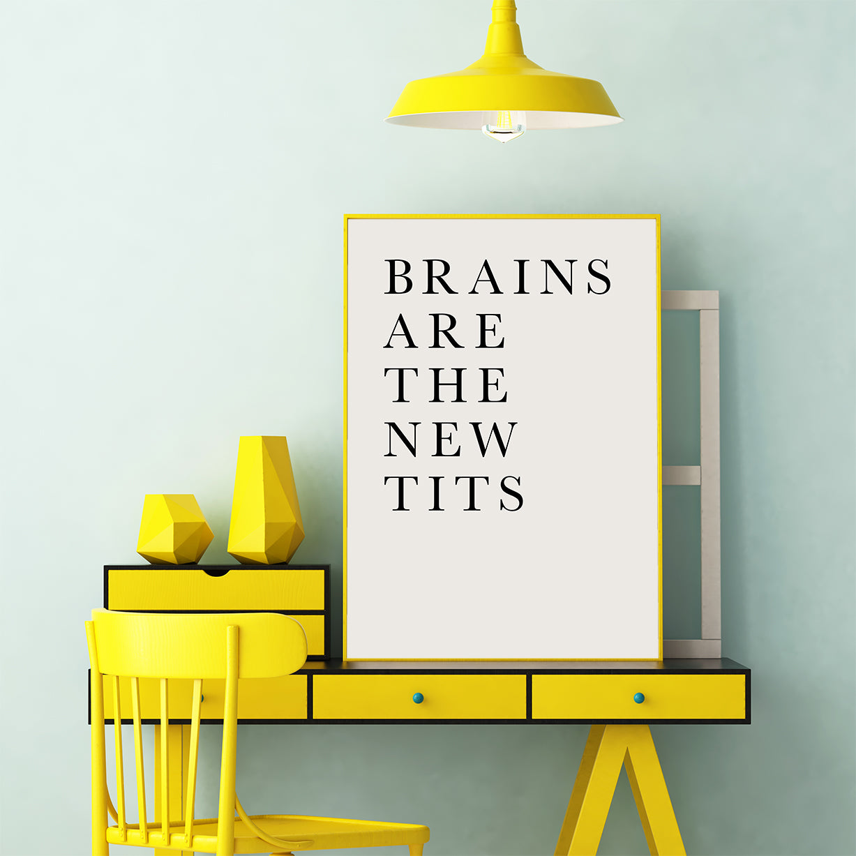 Typography poster print by Kubistika, with an inspirational quote ''Brains are the new tits'', on grey background, office view