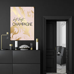 "Typography canvas print, with black text ""but first, Champagne"", on pink and gold marble effect background - room view"