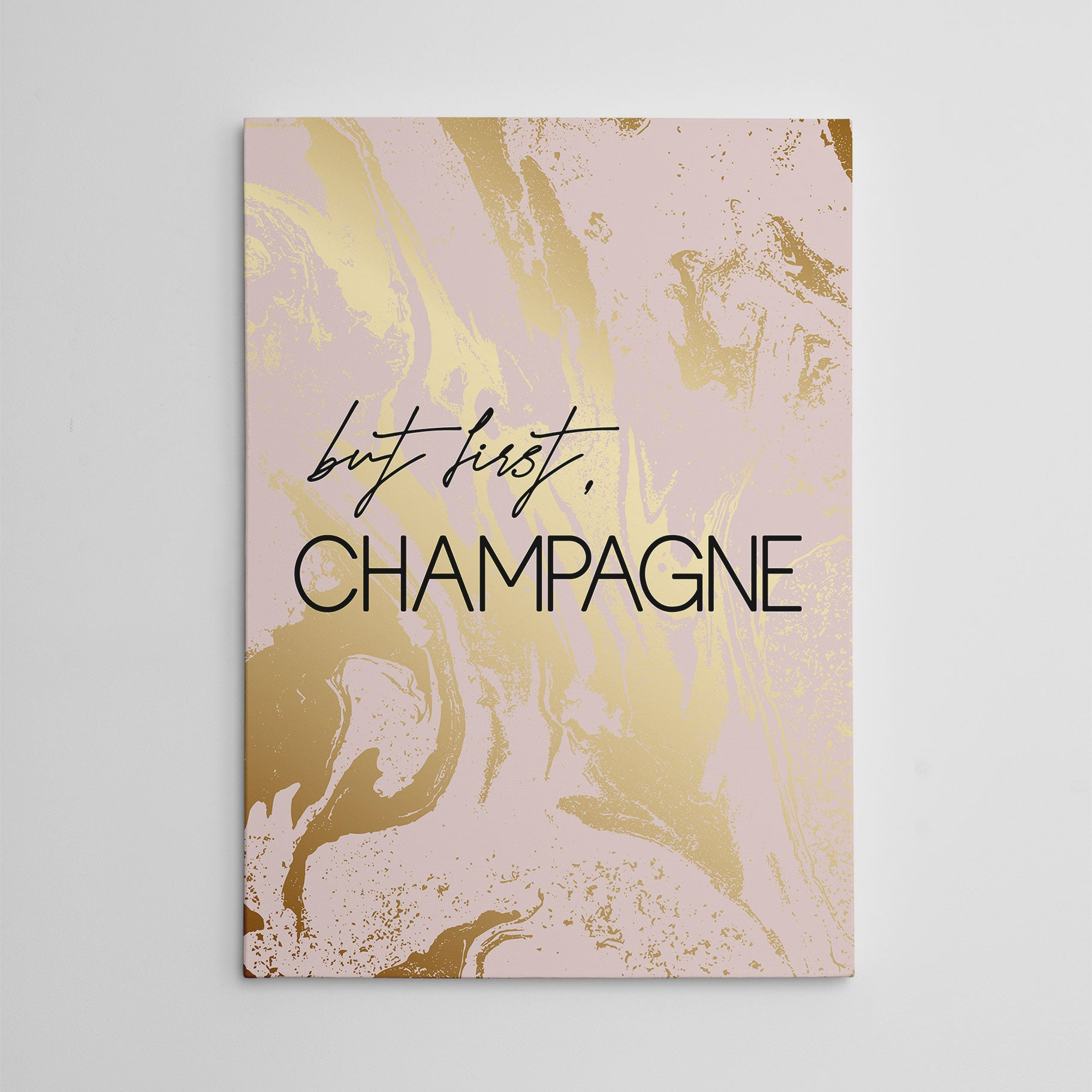 "Typography canvas print, with black text ""but first, Champagne"", on pink and gold marble effect background."