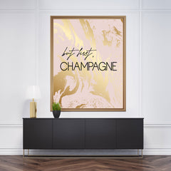 "Typography poster print, with black text ""but first, Champagne"", on pink and gold marble effect background - room view"