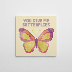 "Stitches style canvas print with colourful butterfly and quote ""You give me butterflies"""