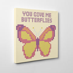 "Stitches style canvas print with colourful butterfly and quote ""You give me butterflies"" - side view"