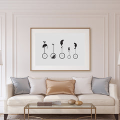 Minimalist illustration print with black cats on monocycle, on grey background, in living room