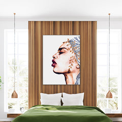 Fashion poster print with a woman's portrait with red lips and head wrap, bedroom view